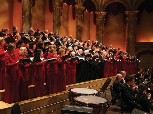 A view of the full choir on stage from the left.
